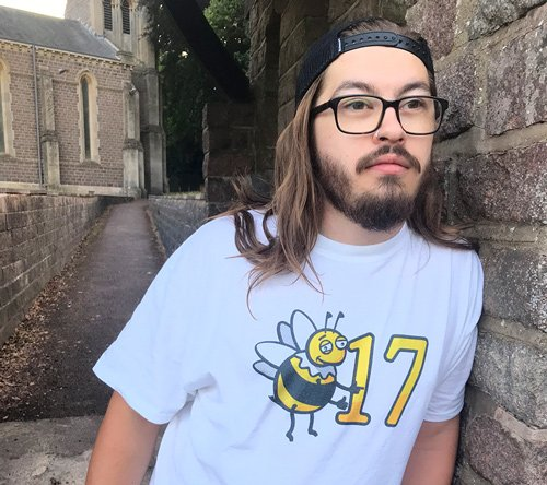 Male model sporting bee17 print on white shirt. lookin smooth.