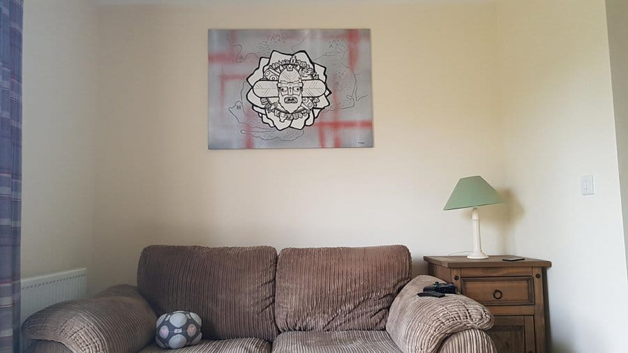 in-situ photo of acrylic painted canvas with mountains, a viking and a snowboard
