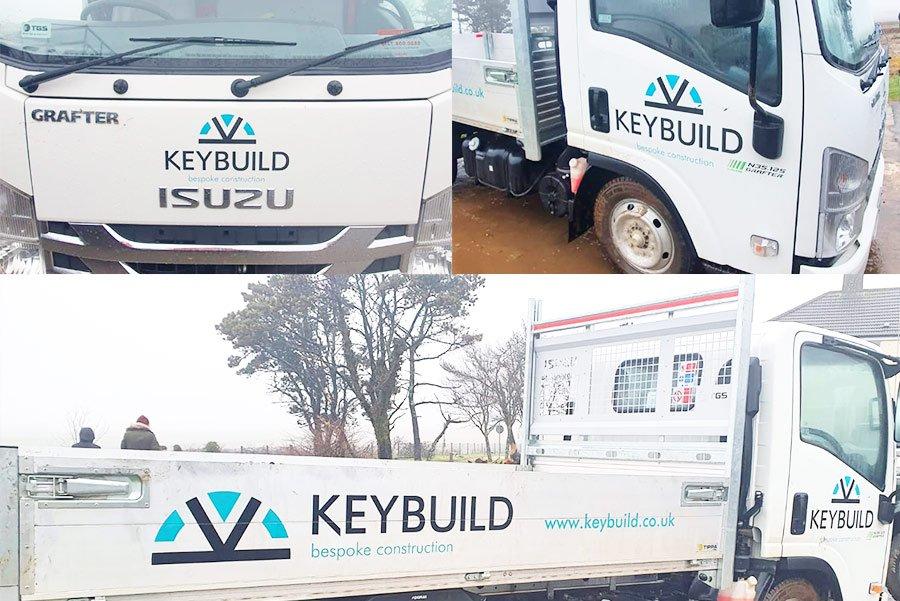 Photos of Keybuild logo on the fleet of trucks