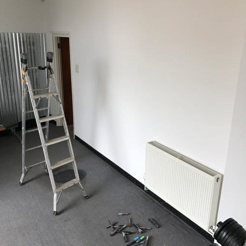 a before photo of the plain wall before starting work