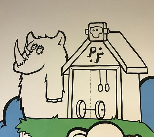 Closeup of the strength shack mural looking at a woolly rhino
