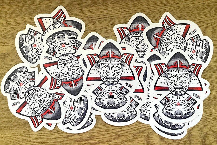 A pile of Foksy samurai mask stickers