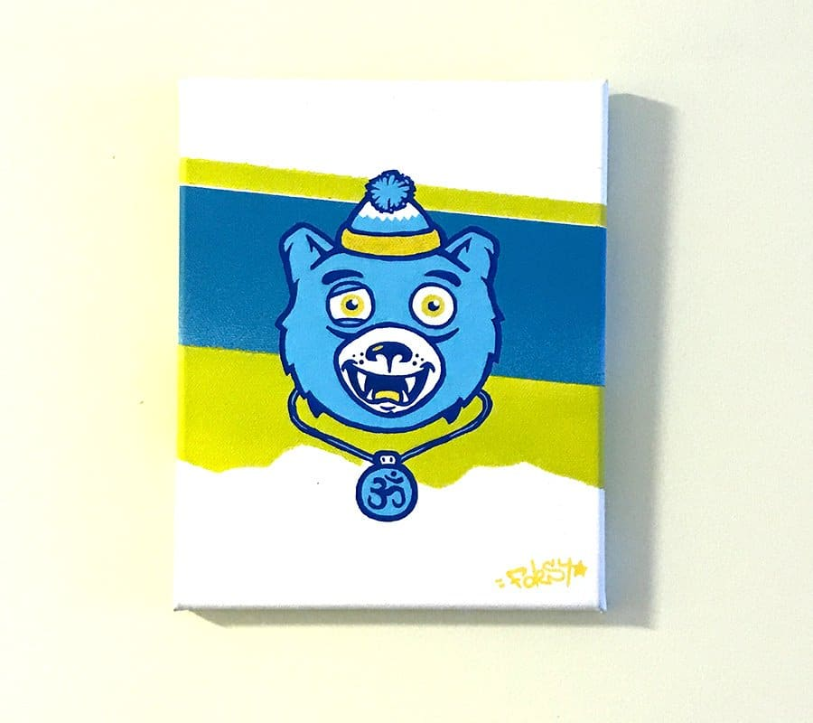 poscas and spray paint used on a canvas depicting a happy bears face